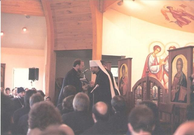 Ken was awarded the Ph.D. in 1986. Fr John then urged him to get a degree from an Orthodox institution, i.e. SVS. He received the M.Th. from SVS, May, 1988. Here, Metropolitan Theodosius hands him his diploma.